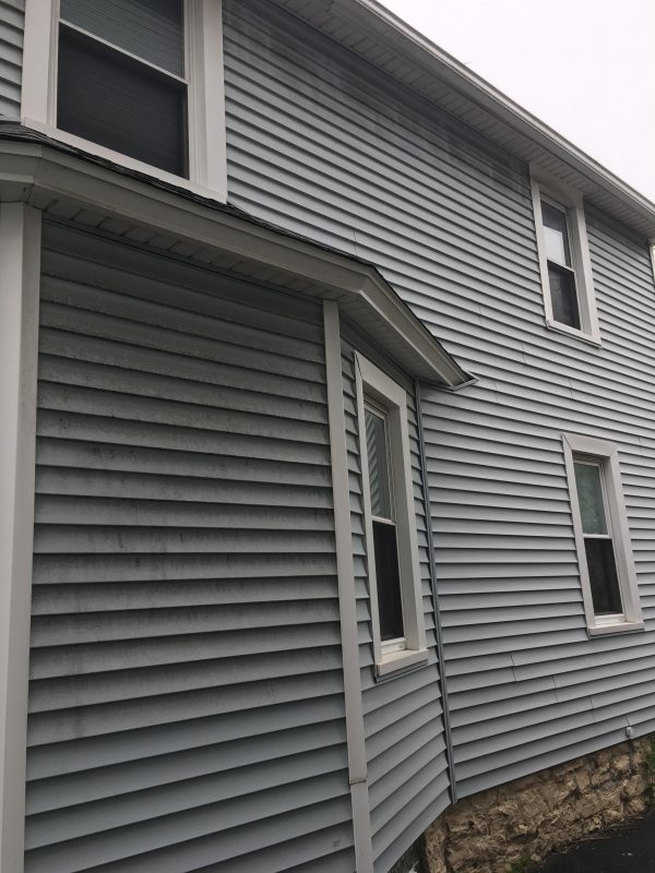 Power wash siding Webster, NY Before